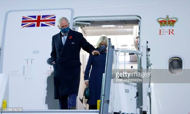 Britain's Prince Charles, Prince of Wales and Camilla, Duchess of Cornwall, get off their plane as they arrive at Berlin Brandenburg Airport in...