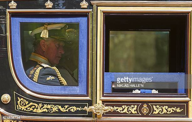 Britain's Prince Charles Prince of Wales and Camilla Duchess of Cornwall ride in the Irish State Coach from Buckingham Palace to the Palace of...