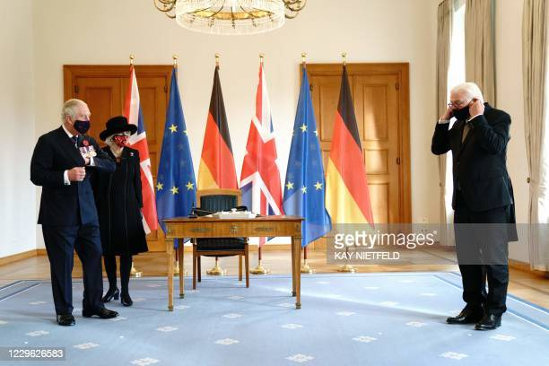 Britain's Prince Charles , Prince of Wales and Camilla , Duchess of Cornwall stand with protective masks next to German President Frank-Walter...
