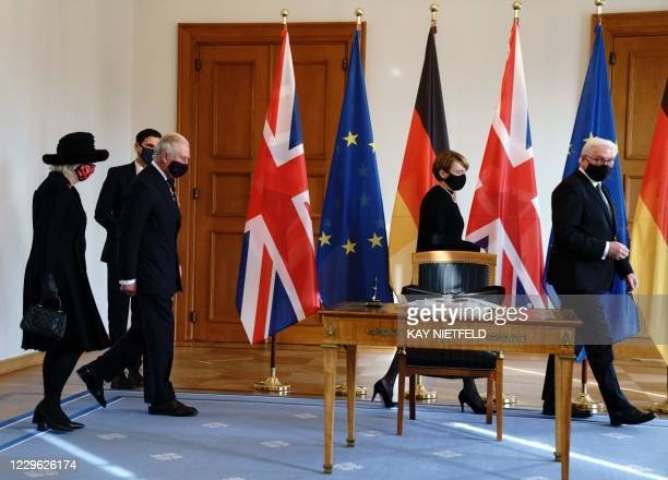 Britain's Prince Charles , Prince of Wales and Camilla , Duchess of Cornwall arrive to sign the guests books next to German President Frank-Walter...