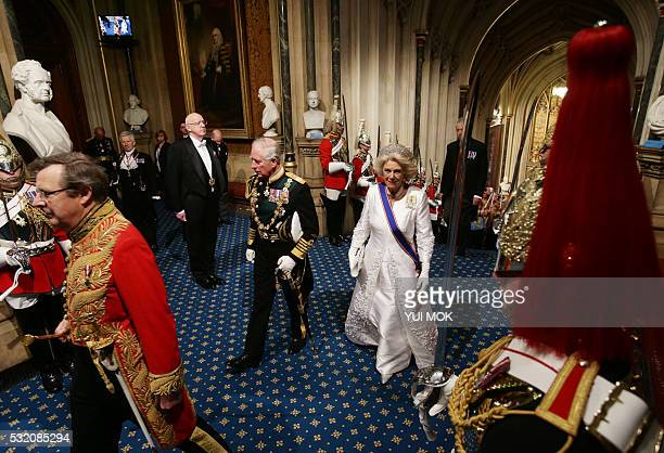 Britain's Prince Charles Prince of Wales and Camilla Duchess of Cornwall walk through Norman Porch in the Houses of Parliament during the State...
