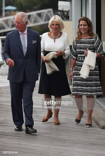 Britain's Prince Charles Prince of Wales and his wife Britain's Camilla Duchess of Cornwall walk with Jordan's Princess Haya bint alHussein as they...