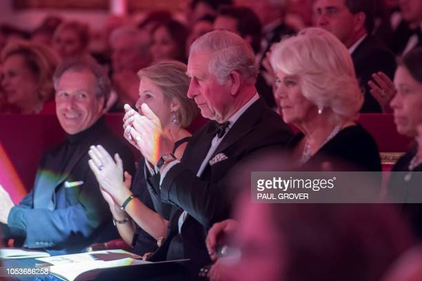 Britain's Prince Charles Prince of Wales and his wife Britain's Camilla Duchess of Cornwall during a gala concert in the Throne Room at Buckingham...