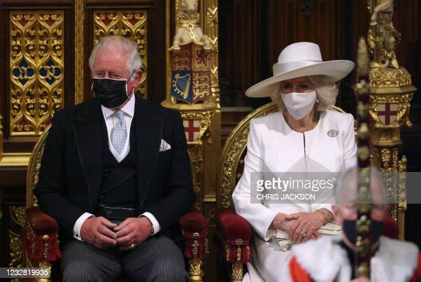 Britain's Prince Charles, Prince of Wales and his wife Britain's Camilla, Duchess of Cornwall, both wearing face coverings, attend the State Opening...