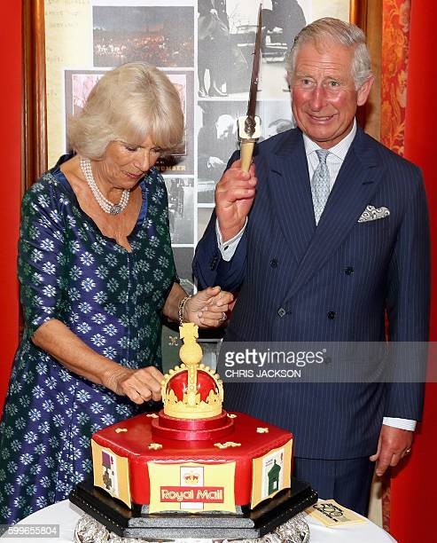 Britain's Prince Charles Prince of Wales and his wife Britain's Camilla Duchess of Cornwall react as they cut into a celeratory cake during a...