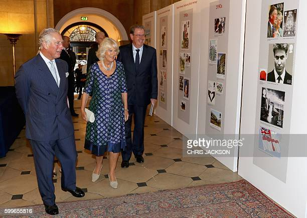 Britain's Prince Charles Prince of Wales and his wife Britain's Camilla Duchess of Cornwall view a selection of postage stamps during a reception to...