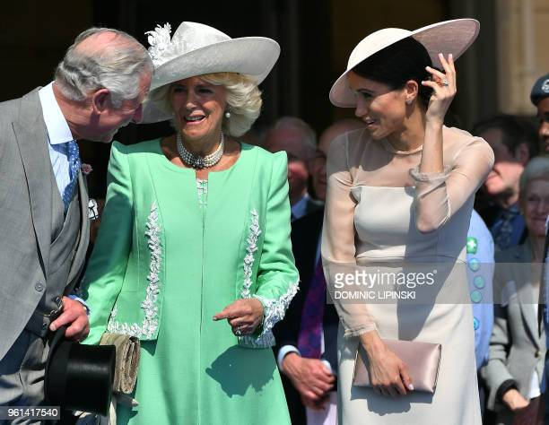 Britain's Prince Charles, Prince of Wales and his wife Britain's Camilla, Duchess of Cornwall , talk with Britain's Meghan, Duchess of Sussex, as her...