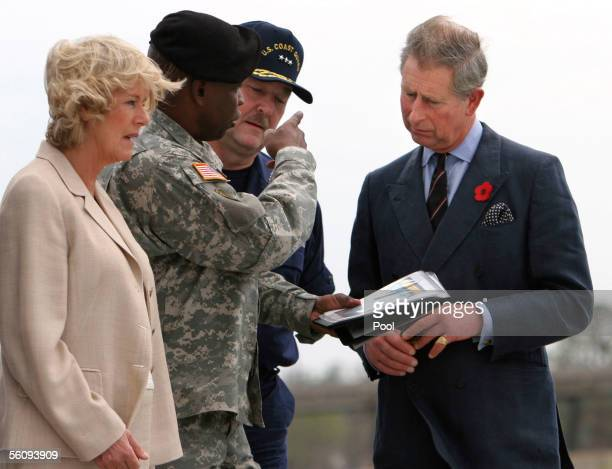 Britain's Prince Charles Prince of Wales and his wife Camilla Duchess of Cornwall talk with Brigadier General Robert Crear of the US Army Corps of...