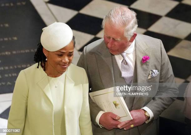 Britain's Prince Charles Prince of Wales and Meghan Markle's mother Doria Ragland depart from St George's Chapel after the wedding ceremony of...