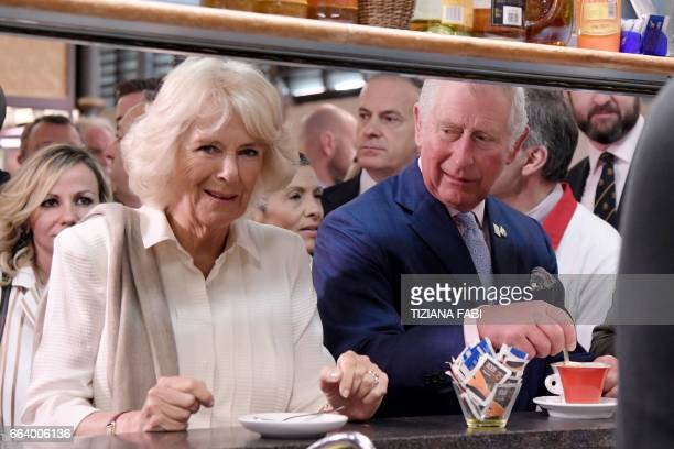 Britain's Prince Charles Prince of Wales and the Duchess of Cornwall Camilla stand at the bar in the market of Sant' Ambrogio on April 3 2017 in...