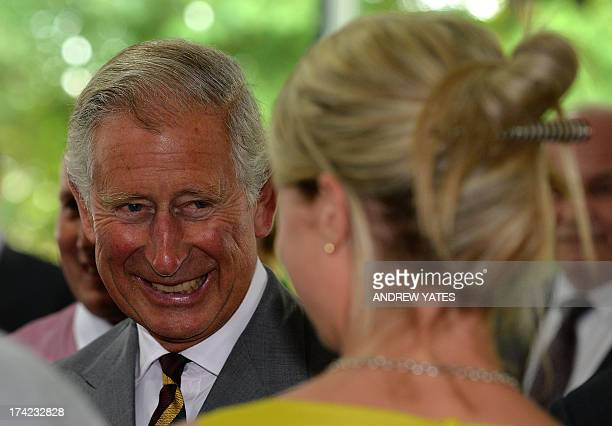 Britain's Prince Charles Prince of Wales arrives at Dovecote Park in Pontefract West Yorkshire on July 22 2013 Prince William's wife Kate was...