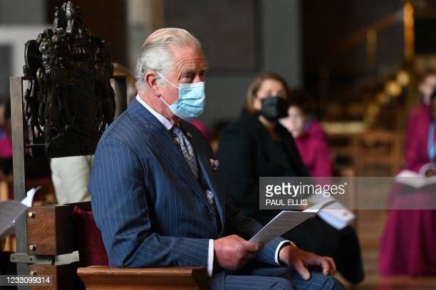 Britain's Prince Charles, Prince of Wales attends a service during a visit to Coventry Cathedral in Coventry, central England on May 25 during the...