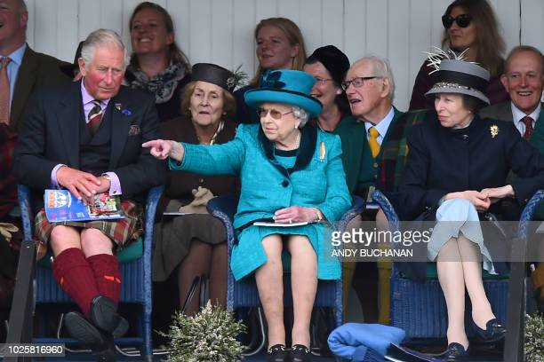 Britain's Prince Charles Prince of Wales Britain's Queen Elizabeth II and Britain's Princess Anne Princess Royal look on during the annual Braemar...