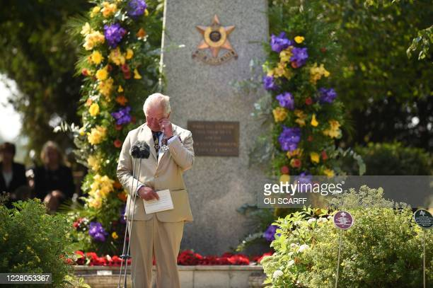 Britain's Prince Charles, Prince of Wales gestures after delivering a speech during a national service of remembrance at the National Memorial...