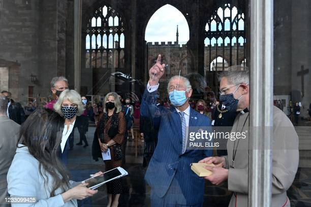 Britain's Prince Charles, Prince of Wales gestures during a visit to Coventry Cathedral in Coventry, central England on May 25 during the 59th...