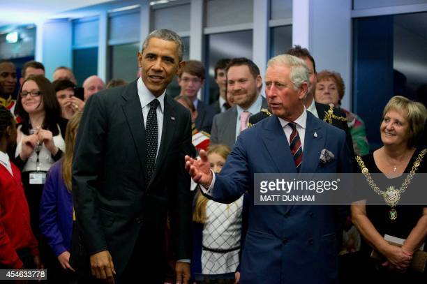 Britain's Prince Charles Prince of Wales gestures to US President Barack Obama during a reception for NATO summit dignitaries in Newport south Wales...