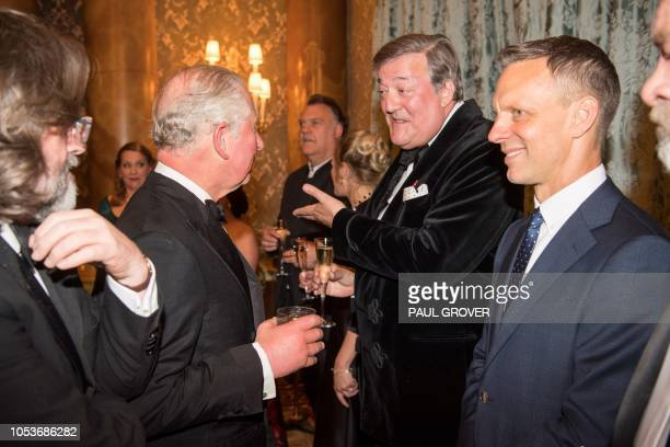 Britain's Prince Charles Prince of Wales greets actor Stephen Fry at Buckingham Palace in London on October 25 during a gala concert to mark 70th...