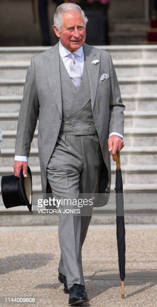 Britain's Prince Charles, Prince of Wales greets guests at the Queen's Garden Party at Buckingham Palace in central London on May 15, 2019.