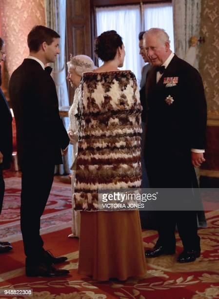 Britain's Prince Charles Prince of Wales greets New Zealand's Prime Minister Jacinda Ardern and her partner Clarke Gayford in the Blue Drawing Room...