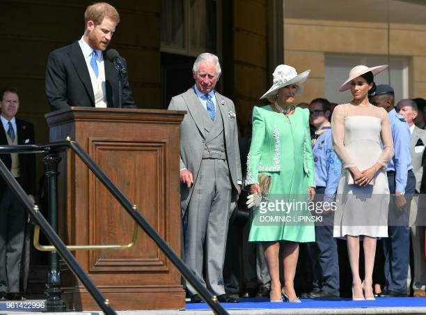 Britain's Prince Charles, Prince of Wales , his wife Britain's Camilla, Duchess of Cornwall , and Britain's Meghan, Duchess of Sussex , listen as her...