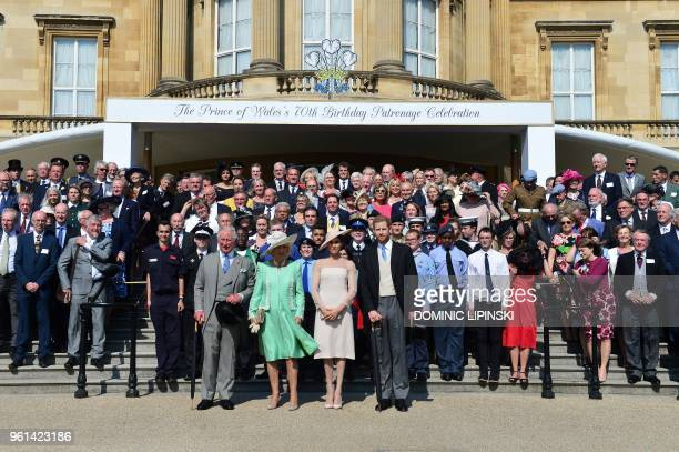 Britain's Prince Charles, Prince of Wales, his wife Britain's Camilla, Duchess of Cornwall, Britain's Meghan, Duchess of Sussex, and her husband...