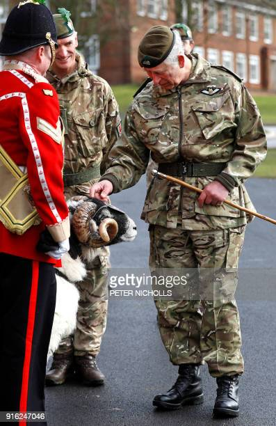 Britain's Prince Charles Prince of Wales inspects troops and meets Private Derby XXII a Swaledale Ram and the Regimental Mascot whilst on a visit to...