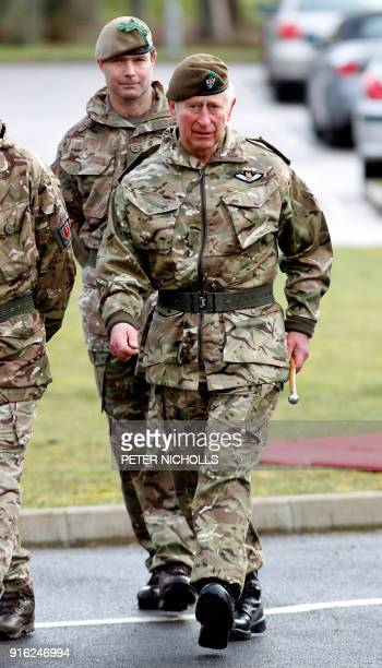 Britain's Prince Charles Prince of Wales inspects troops during a visit to The Mercian Regiment at their barracks in Bulford Wiltshire on February 9...