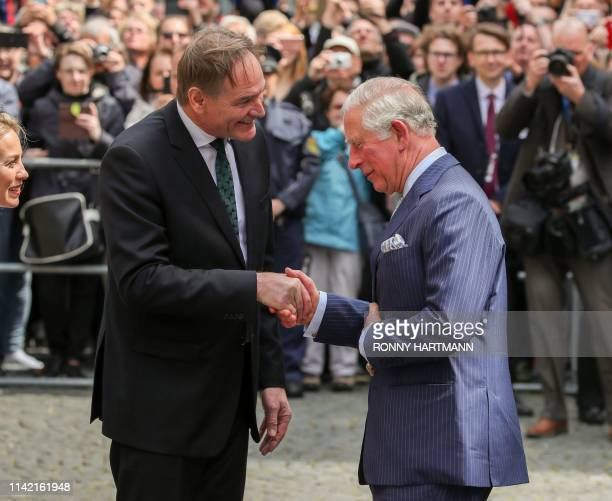 Britain's Prince Charles Prince of Wales is welcomed by the Mayor of Leipzig Burkhard Jung and his wife Ayleena Jung as they arrive at the St Thomas...
