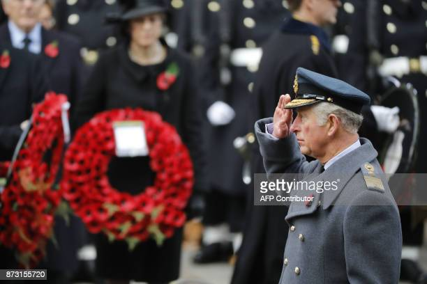 Britain's Prince Charles Prince of Wales lays a wreath during the Remembrance Sunday ceremony at the Cenotaph on Whitehall in central London on...