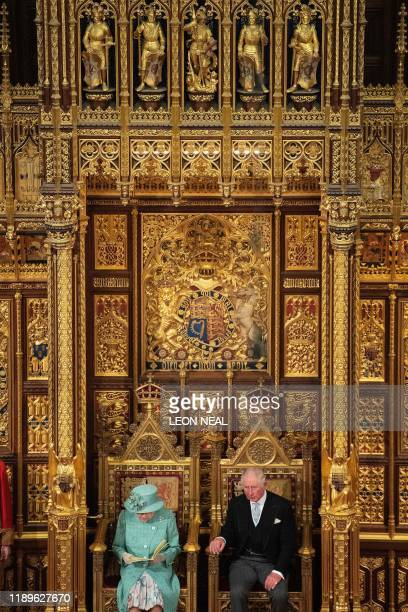 Britain's Prince Charles, Prince of Wales listens as Britain's Queen Elizabeth II reads the Queen's Speech on the The Sovereign's Throne in the House...