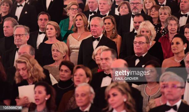Britain's Prince Charles Prince of Wales listens during a gala concert in the Throne Room at Buckingham Palace in London on October 25 to mark 70th...
