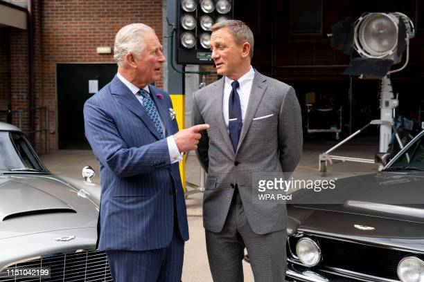 Britain's Prince Charles , Prince of Wales meets British actor Daniel Craig as he tours the set of the 25th James Bond Film at Pinewood Studios on...