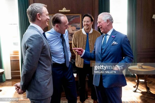 Britain's Prince Charles , Prince of Wales meets British actors Ralph Fiennes , Daniel Craig and US Director Cary Joji Fukunaga as he tours the set...