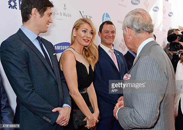 Britain's Prince Charles Prince of Wales meets English tv presenter Vernon Kay English model and presenter Tess Daly and English actor Dominic West...
