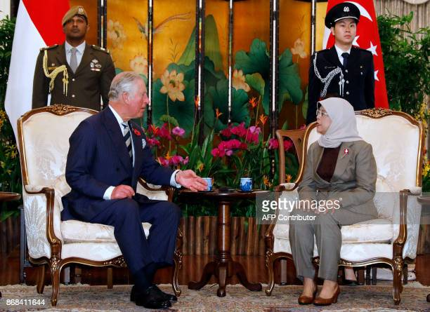 Britains Prince Charles Prince of Wales meets Singapores President Halimah Yacob at the Istana in Singapore October 31 2017 Britain's Prince Charles...