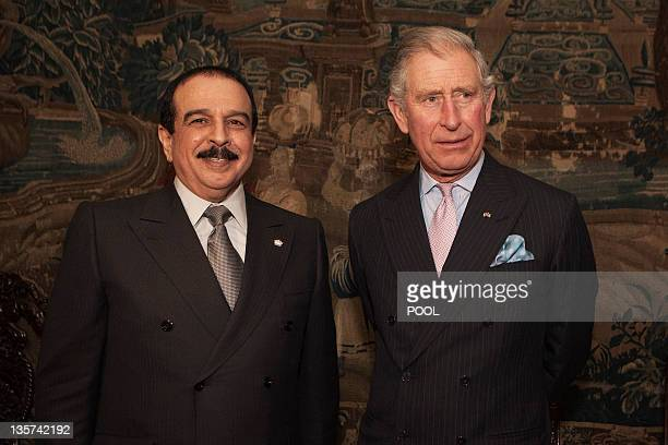 Britain's Prince Charles Prince of Wales poses with Bahrain's King Hamad bin Issa alKhalifa during a reception at Clarence House in London on...