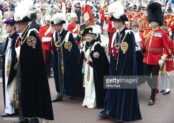 Britain's Prince Charles Prince of Wales Queen Elizabeth II and Prince William Duke of Cambridge attend the Most Noble Order of the Garter service at...