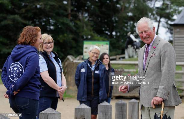 Britain's Prince Charles Prince of Wales reacts a he socially distances while meeting staff members during during his visit to Cotswold Farm Park...