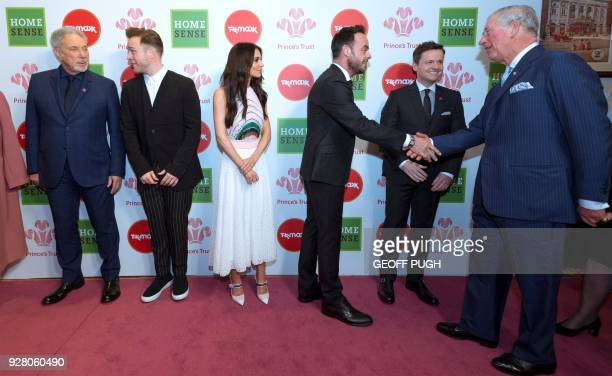 Britain's Prince Charles Prince of Wales reacts as he meets Celebrity Trust Ambassadors Weslh singer Tom Jones English singer Olly Murs English...