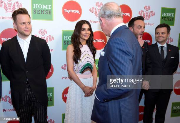 Britain's Prince Charles Prince of Wales reacts as he meets Celebrity Trust Ambassadors English singer Olly Murs English singer Cheryl and English...