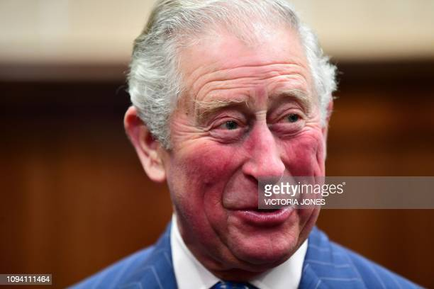 Britain's Prince Charles Prince of Wales reacts as he visits The Supreme Court in central London on February 5 to commemorate its 10th anniversary...