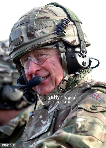 Britain's Prince Charles Prince of Wales rides on a Warrior Tracked Armoured Vehicle during a training exercise whilst on a visit to The Mercian...