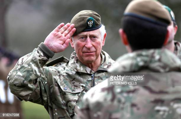 Britain's Prince Charles Prince of Wales salutes during a visit to The Mercian Regiment at their barracks in Bulford Wiltshire on February 9 2018 /...
