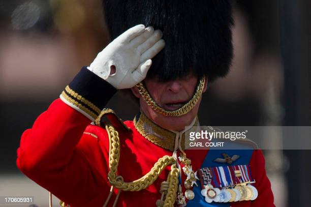 Britain's Prince Charles Prince of Wales salutes during the Queen's Birthday Parade 'Trooping the Colour' at Horse Guards Parade in London on June 15...