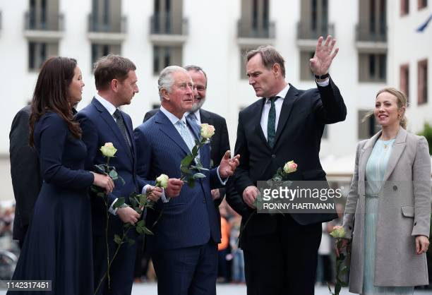Britain's Prince Charles Prince of Wales Saxonys Prime Minister Michael Kretschmer and his partner Annett Hofmann the Mayor of Leipzig Burkhard Jung...
