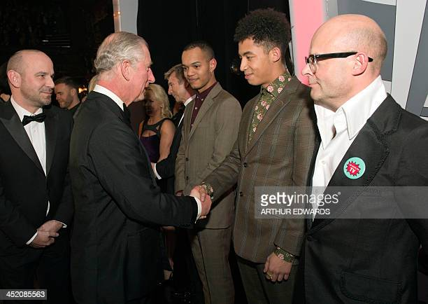 Britain's Prince Charles Prince of Wales shakes hands with Jordan Stephens of British hip hop band Rizzle Kicks as the other half of the duo Harley...