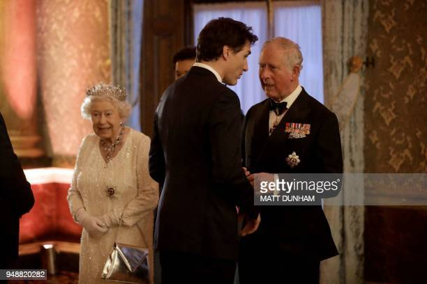 Britain's Prince Charles Prince of Wales speaks with Canada's Prime Minister Justin Trudeau in a receiving line in the Blue Drawing Room during a...