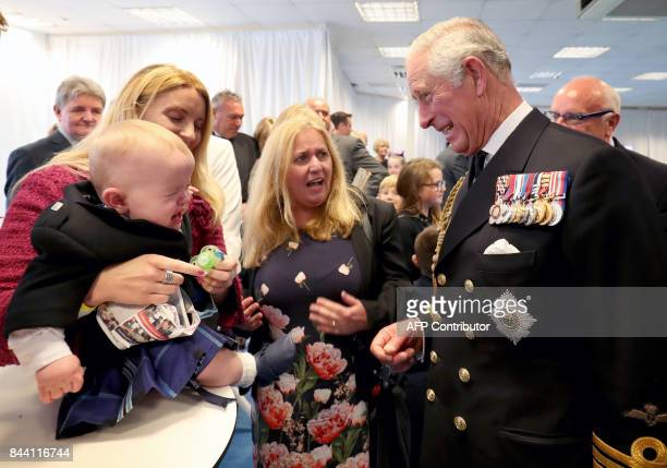Britain's Prince Charles Prince of Wales styled as the Duke of Rothesay while in Scotland meets 11 month old Myles Johnston at a reception following...