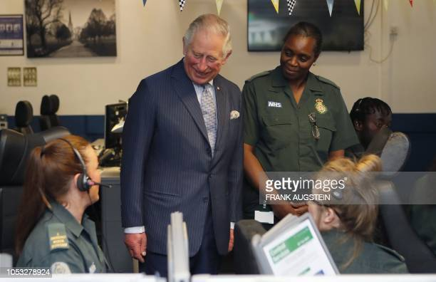 Britain's Prince Charles Prince of Wales talks with staff during a visit to the London Ambulance Service Headquarters in London on October 25 where...