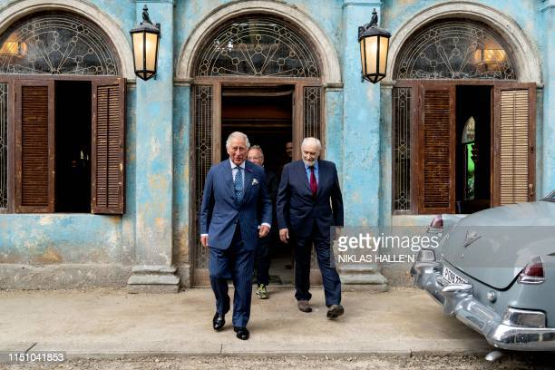 Britain's Prince Charles Prince of Wales tours the set of the 25th James Bond Film with producer Michael G Wilson at Pinewood Studios in Iver Heath...